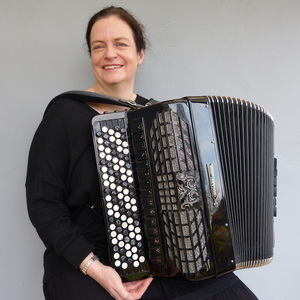 Image of lady with accordion with plain grey background