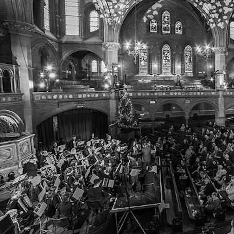 Image in black and white of the side of London Accordion Orchestra in concert at Union Chapel